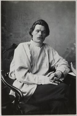 Portrait of Maxim Gorky sitting in an armchair wearing a light shirt. (14728267252)