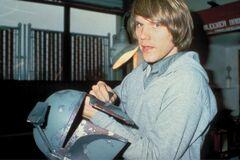 Joe Johnston with helmet of Boba Fett
