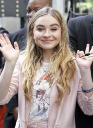 Sabrina holding a pen lol