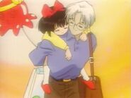 Professor Tomoe with child Hotaru