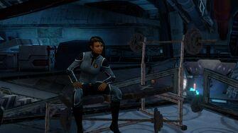 Asha sitting down on a work bench