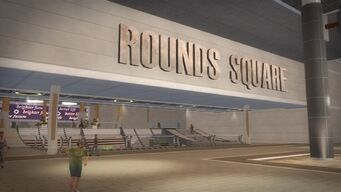Rounds Square Shopping Center name sign above stairs