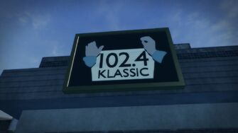 102.4 Klassic advertisement on the Rounds Square Shopping Center