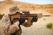 United States Navy SEAL with a SCAR-H Rifle