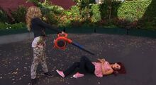 Sam using a leafblower to clean Cat in Pilot
