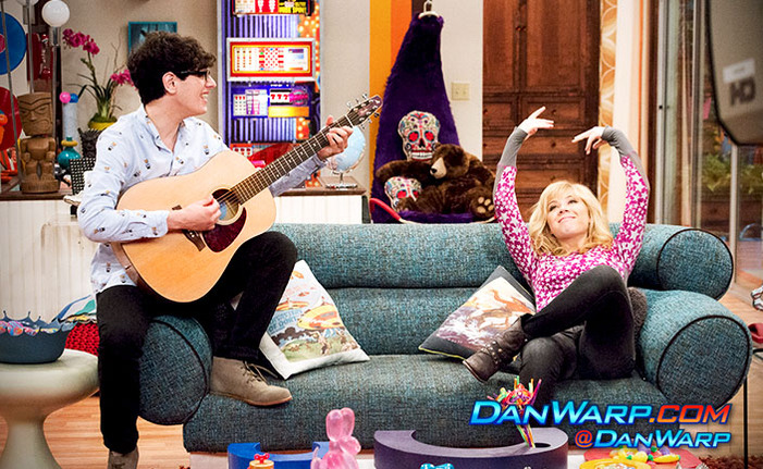 image robbie holding a guitar and sam in apartment 22
