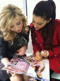 Ariana and Jennette reading M Magazine