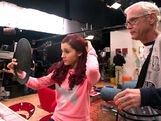 Ariana looking at herself in a mirror