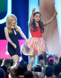 Jennette and Ariana dancing on stage at KCAs 2013