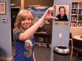 Jennette posing with a picture of her grandpa