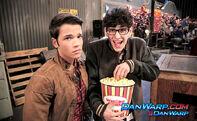 Robbie eating popcorn and Freddie
