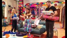 Goomer and Cat holding presents with Sam next to them