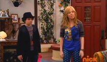 Dice and Sam standing in front of the door