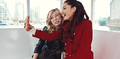 Ariana & Jennette taking a selfie.png