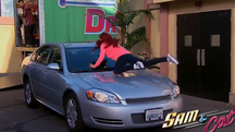 Cat landing on a car in the first promo