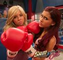 Jennette and Ariana wearing boxing gloves on set
