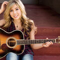 Jennette McCurdy holding a guitar.jpg
