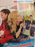 Scan of Ariana and Jennette with 1D poster in M Magazine