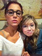 Ariana and Jennette wearing glasses