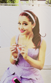 Ariana Grande holding a small box.png
