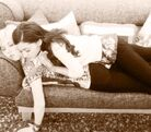 Ariana and Jennette lying on a couch