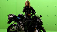 Photo behindthescenes 10 129054127151 Emilie Ullerup gets her biker look on shooting a scene from Sanctuary's first season.