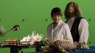 Photo behindthescenes 01 129054126872 Amanda Tapping and Christopher Heyerdahl in a green screen scene from Sanctuary.