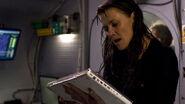 Helenmagnus07 128410183015 A dangerous parasite attacks Doctor Helen Magnus in ''Requiem.''
