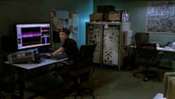 Sachi looks at Erickson, Perez and Hoffman as they enter the lab