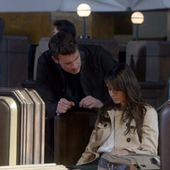 Jake finds Elise with a bullet through her chest at the train station they were supposed to meet at