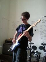 Raviv playing guitar