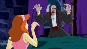 Vampire scares Daph in Fortescu Castle room