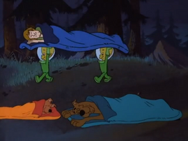 Aliens taking a sleeping Shaggy