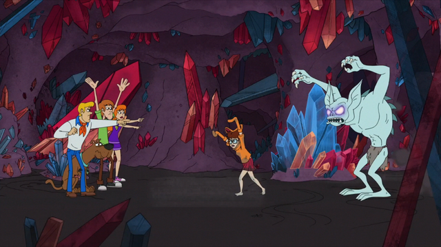 File:Gang points out the Crystal Crawler behind Velma.png