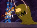Alien grabs Shag and Scoob