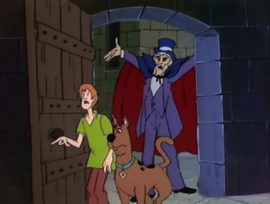 Night Ghoul behind Shaggy and Scooby
