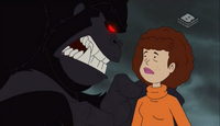 A blind Velma talking to the Ape Man