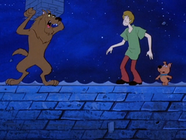 A transformed Scooby preparing to smash Shaggy and Scrappy