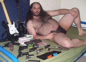 Creepy speedo guy with guns
