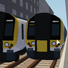 Two legacy Class 350 stopping at <a href=