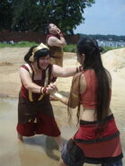Katara and toph s mud fight by aichan25