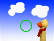 Quacker the Duck With the Green Circle on a Blue Sky Background