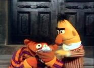 Ernie cries over the number 2 and later the letter E