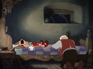Geppetto mourns over Pinocchio's death and cries