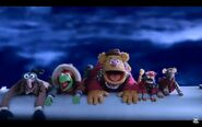 The Muppets fly on a wing of the plane
