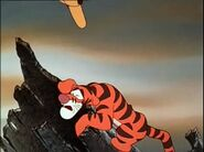 Tigger is stuck on a broken log crying