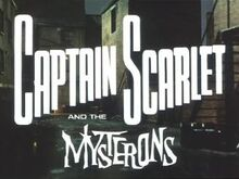 "In bold, white letters, the words ""Captain Scarlet"" are superimposed on the backdrop of a derelict, night-time alleyway. Added at the bottom of the picture are more words – ""and the Mysterons"" – the last of which is in white, spikey lettering. The full title is thus revealed to be ""Captain Scarlet and the Mysterons""."