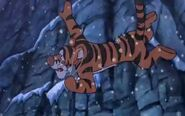 Tigger falls from a high cliff after the branch cracks