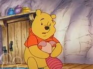 Piglet is sad that he'll miss Pooh as he moves away