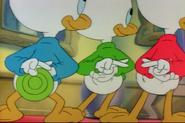 The boys with fingers crossed behind their backs in Scrooge's Last Adventure